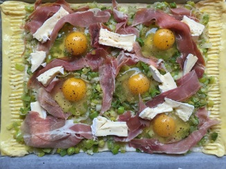 Prosciutto, leek and egg tart, before being baked