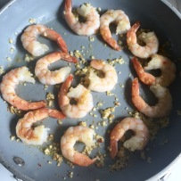 Sautéing the shrimp with garlic