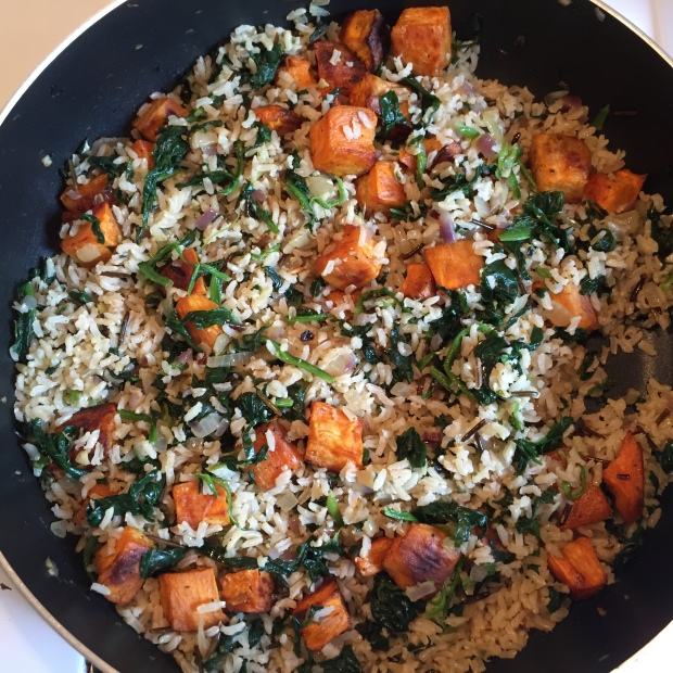 Brown rice with roasted sweet potatoes and spinachimage