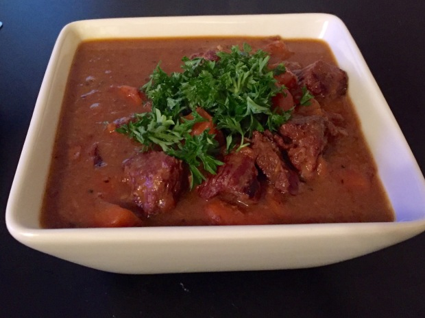 Veal stew with carrots and brandy